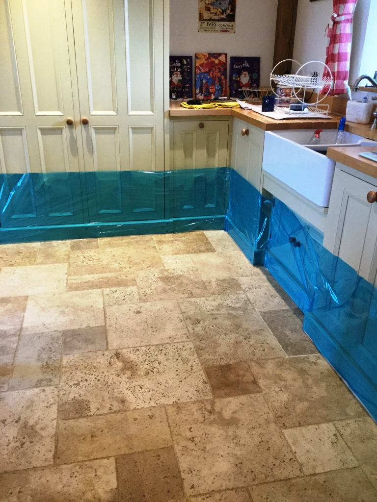 Badly Stained And Pitted Travertine Tiled Kitchen Floor