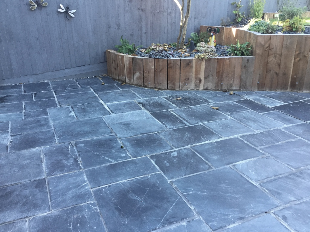 Restoring A Riven Slate Patio Suffering From Grout Haze In