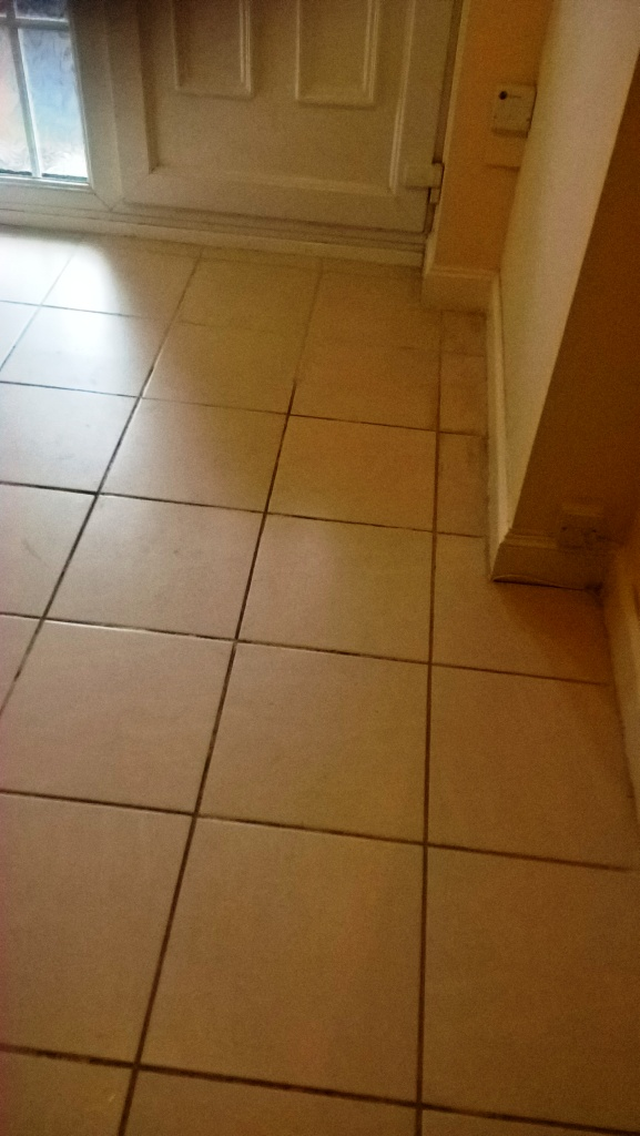Dirty Grout Lines Refreshed On A Ceramic Tiled Hallway In