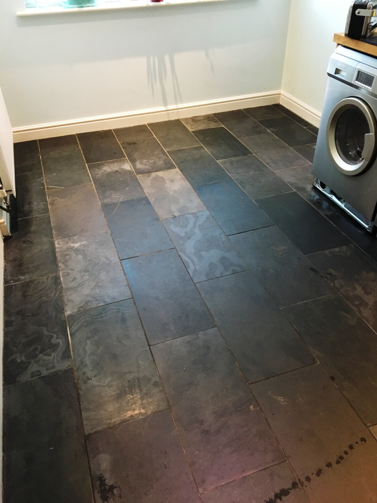 repairing a scratched slate tiled kitchen floor in