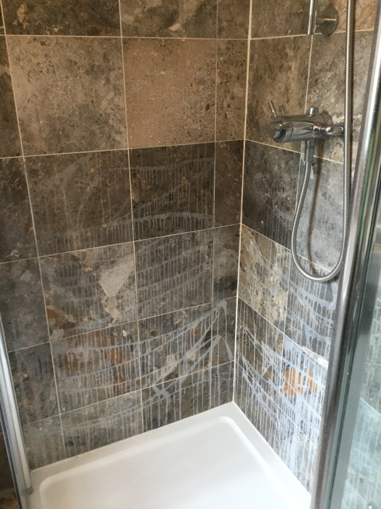 Ruined marble shower tiles restored in sharnbrook tile for Best product for cleaning bathroom tiles
