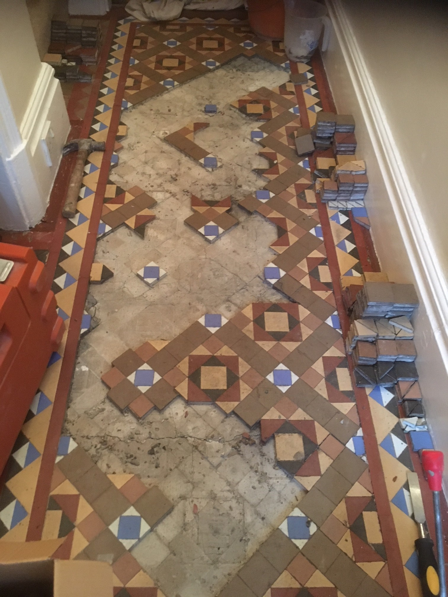Original Victorian Hallway With Loose Tiles Restored In