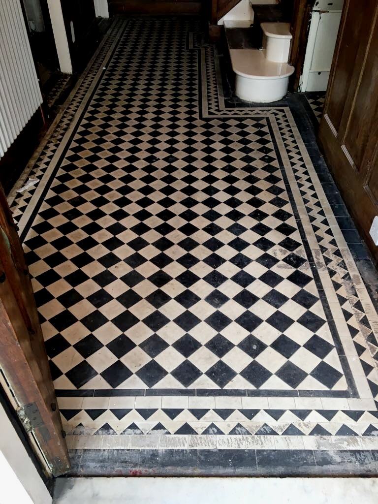 Restorative cleaning of a edwardian geometric tiled hallway in west edwardian black and white geometric hall floor before restorative clean and seal dailygadgetfo Image collections