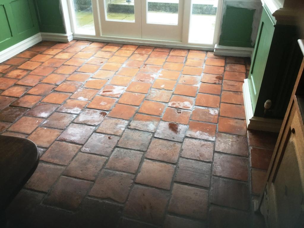 dull spanish terracotta tiled floor