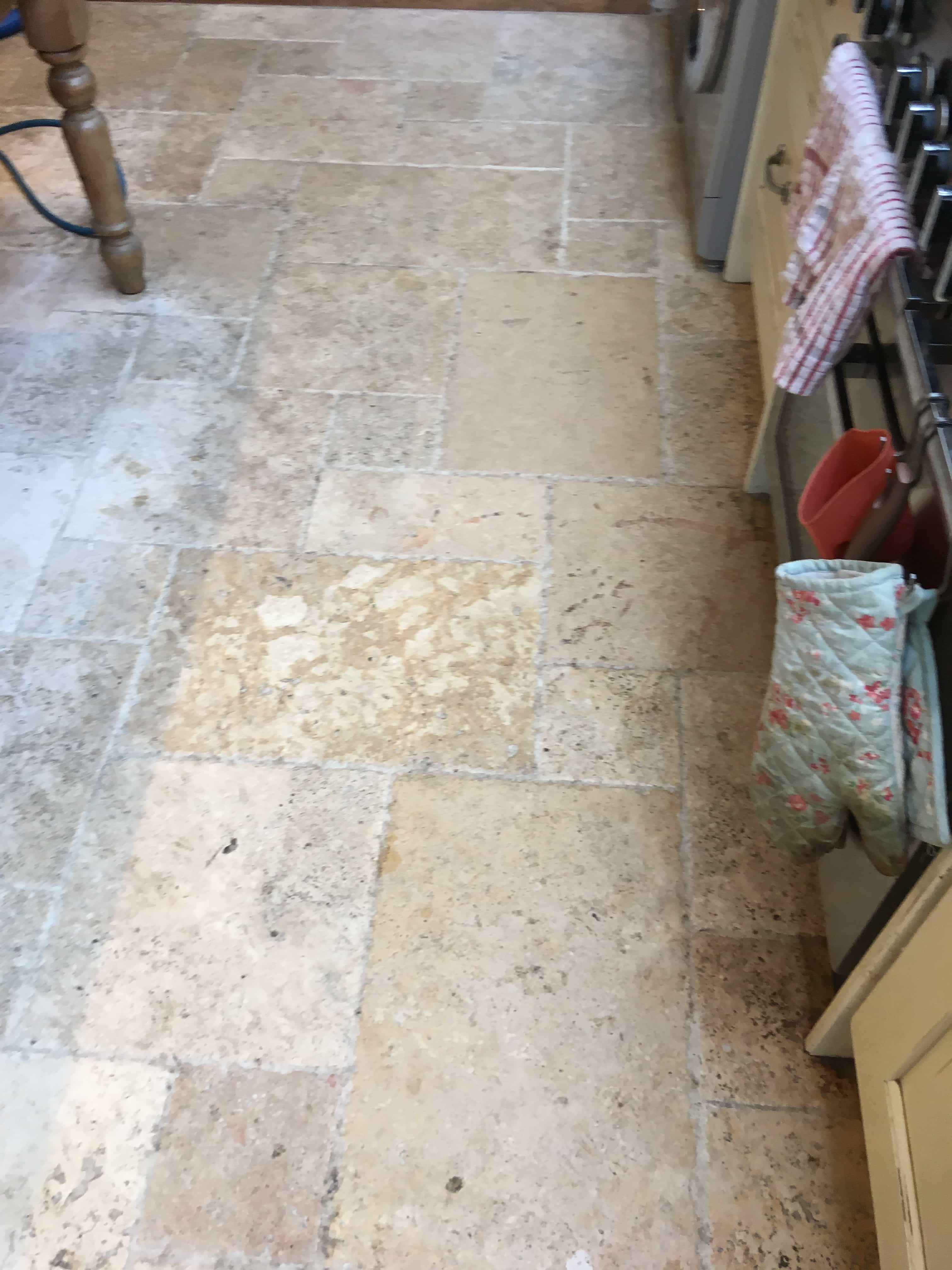 dirty travertine tiled kitchen floor deep cleaned and